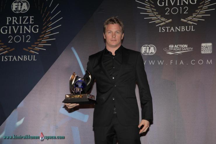 Kimi receiving his trophy
