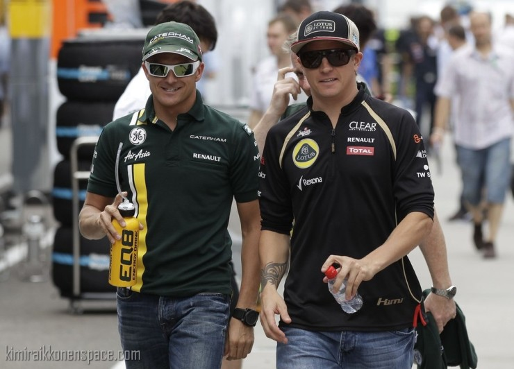 Caterham Formula One driver Kovalainen of Finland and compatriot Lotus F1 Formula One driver Raikkonen walk in the paddock ahead of the Hungarian F1 Grand Prix at the Hungaroring circuit near Budapest