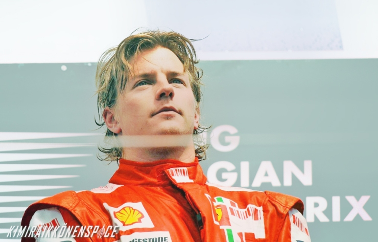 Ferrari's Finnish driver Kimi Raikkonen stands on the podium of the Spa-Francorchamps Circuit on August 30, 2009 in Francorchamps, after the Formula One Belgian Grand Prix. Ferrari's Finnish driver Kimi Raikkonen won the race ahead of Force India's Italian driver Giancarlo Fisichella and Red Bull's German driver Sebastian Vettel.               AFP PHOTO / JOHN THYS (Photo credit should read FRED DUFOUR/AFP/Getty Images)