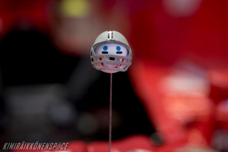 "Kimi Raikkonen: ""The guys in the garage know very well how much I like ice hockey, so they put a little ball on the car's antenna and added a nice paintjob to make it look like a player!"""